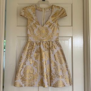 Cap sleeve white and gold dress